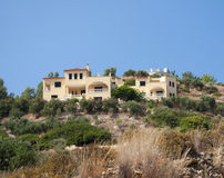 Holiday villa. In mediterranean landscape on hill top Royalty Free Stock Image