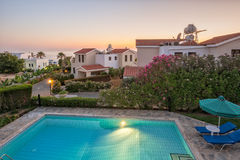 Holiday villas in sunset light Royalty Free Stock Images