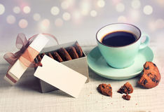 Holiday vintage hot drink coffee & cookies on blur background. Royalty Free Stock Images