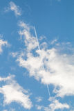 Holiday voyage. Blue sky with clouds and condensation trail, holiday voyage Royalty Free Stock Photography