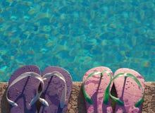 Holiday weekend fun beside swimming pool Stock Image