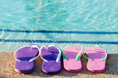 Holiday weekend fun beside swimming pool Stock Photo
