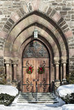 Holiday Welcome. Holiday wreathes welcome visitors to the First Reformed Church of Schenectady, New York Stock Image