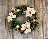 Holiday white Poinsettia Christmas wreath on rustic cedar wooden royalty free stock image