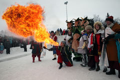Holiday Wide Maslenitsa. Artists spewing fire Stock Photo