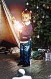 Holiday, winter, boy, little, kid, lantern,. Christmas. Little boy with a Christmas lantern near a Christmas tree Royalty Free Stock Photography