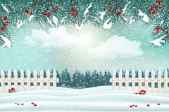 Holiday winter landscape background with fence and tree branches with red berries royalty free stock image