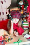 Holiday wish. Girl reflects on gift list Royalty Free Stock Photos