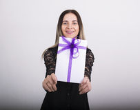 Holiday woman happy smile hold gift card present, excited woman wear dress Stock Image