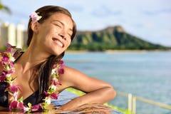 Holiday woman relaxing enjoying sun at pool resort Stock Image