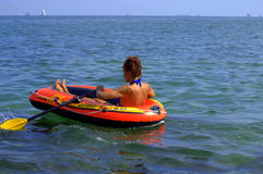 Holiday woman rows boat stock photo