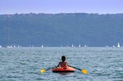 Holiday woman rows boat stock image
