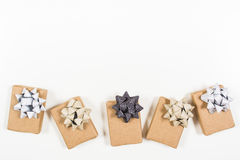 Holiday wrapped gifts with bows Royalty Free Stock Photos