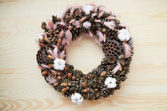 Holiday wreath with cones, cinnamon, berries, acorn on a tree texture Stock Photos