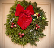 Holiday wreath hanging on a door Royalty Free Stock Images