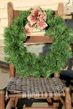 Holiday wreath hanging from old cane chair Stock Image