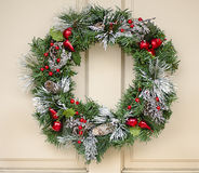 Holiday Wreath Hanging On Door Royalty Free Stock Photo