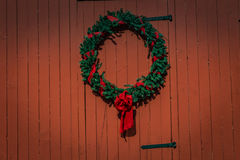 Holiday Wreath on red barn Stock Photography
