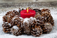 Holiday Wreath with Red Candle on aged Wood Royalty Free Stock Photos