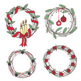 Holiday wreaths. Four wreath with a different design. New Year, berry and floral decorations Stock Photography