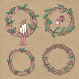 Holiday wreaths. Four wreath with a different design. New Year, berry and floral decorations. Kraft background Royalty Free Stock Photography