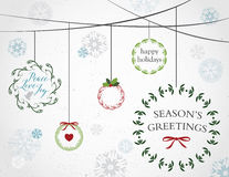 Holiday Wreaths and Snowflakes Stock Images