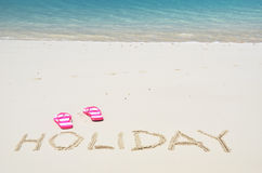 HOLIDAY writing on the beach Royalty Free Stock Images