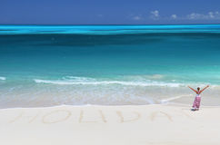 Holiday writing on the desert beach Royalty Free Stock Photo