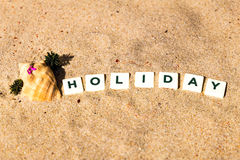 Holiday written Stock Images