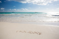 Holiday written in the sand on a beach. In Mexico Stock Photography