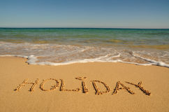 Holiday written on the shore royalty free stock photos