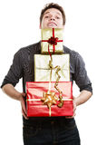 Holiday. Young man giving presents gifts boxes Stock Image