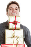 Holiday. Young man giving presents gifts boxes Stock Images