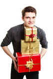 Holiday. Young man giving presents gifts boxes Royalty Free Stock Images
