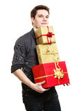Holiday. Young man giving presents gifts boxes Royalty Free Stock Image