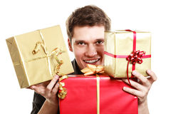 Holiday. Young man giving presents gifts boxes Royalty Free Stock Photos