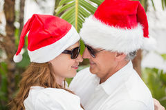 Holidaying couple celebrating christmas Royalty Free Stock Images