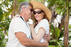 Holidaying couple hugging and smiling Royalty Free Stock Photos