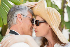 Holidaying couple hugging and smiling Royalty Free Stock Image