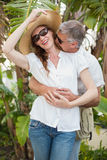 Holidaying couple hugging and smiling Stock Image