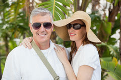 Holidaying couple smiling at camera Stock Photos