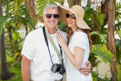 Holidaying couple smiling at camera Royalty Free Stock Photography