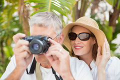 Holidaying couple taking a photo Stock Images