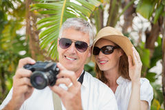 Holidaying couple taking a photo Stock Photos