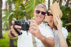 Holidaying couple taking a selfie Royalty Free Stock Photography