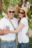 Holidaying couple taking a selfie Royalty Free Stock Photo