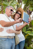 Holidaying couple taking a selfie Stock Photo