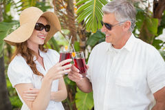 Holidaying couple toasting with cocktails Royalty Free Stock Photography
