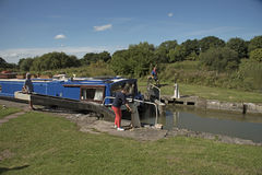 Holidaymaker opening lock on an English canal UK Stock Photo