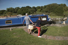 Holidaymaker opening lock on an English canal UK Stock Photos